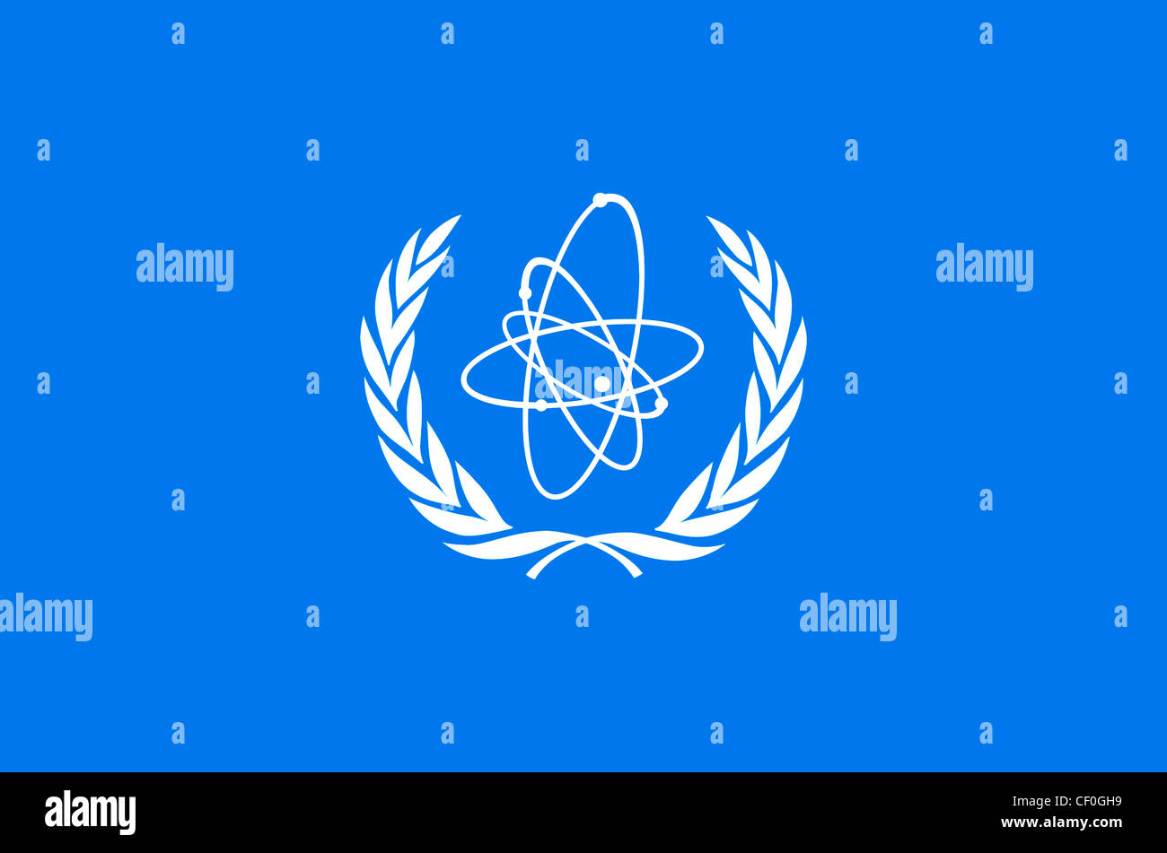 Flag of the International Atomic Energy Agency IAEA with the coat of arms of the organisation based in Vienna. Stock Photo