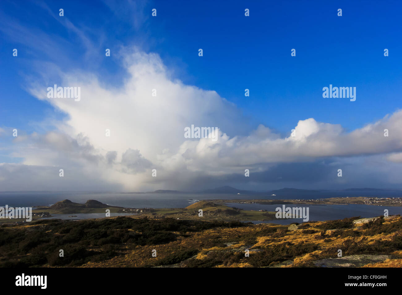 Rainclouds over an Island, seen from the island of Klosteroy, close to Stavanger, Norway - Stock Image