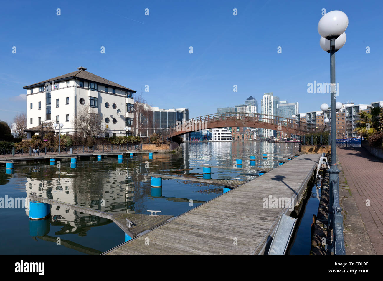 Clippers Quay marina, part of Millwall Outer Dock with Canary wharf in the background, Isle of Dogs, Tower Hamlets, - Stock Image