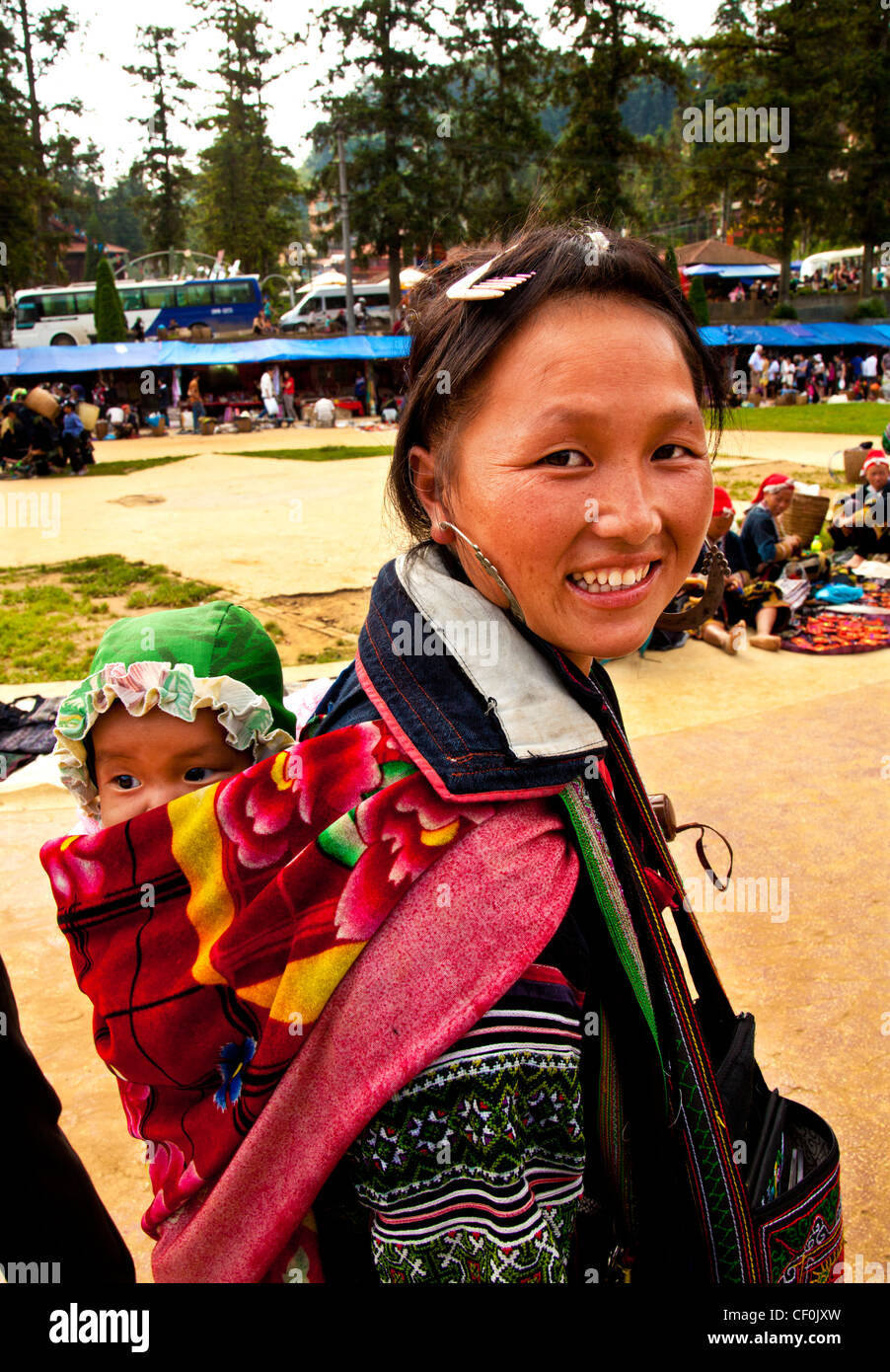 An Hmong hill tribe mother and baby in a tourist market Sapa, Vietnam - Stock Image