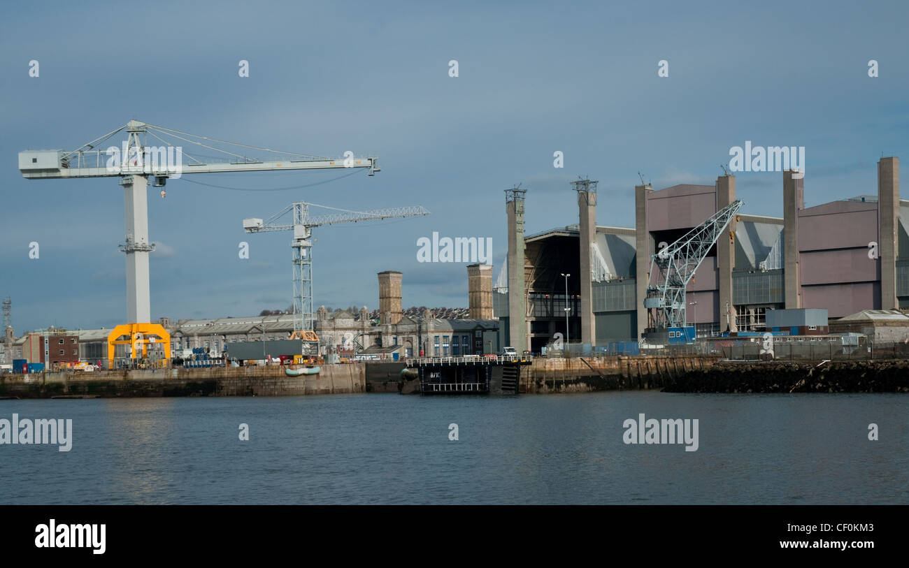 Docks and cranes on a shore. Stock Photo