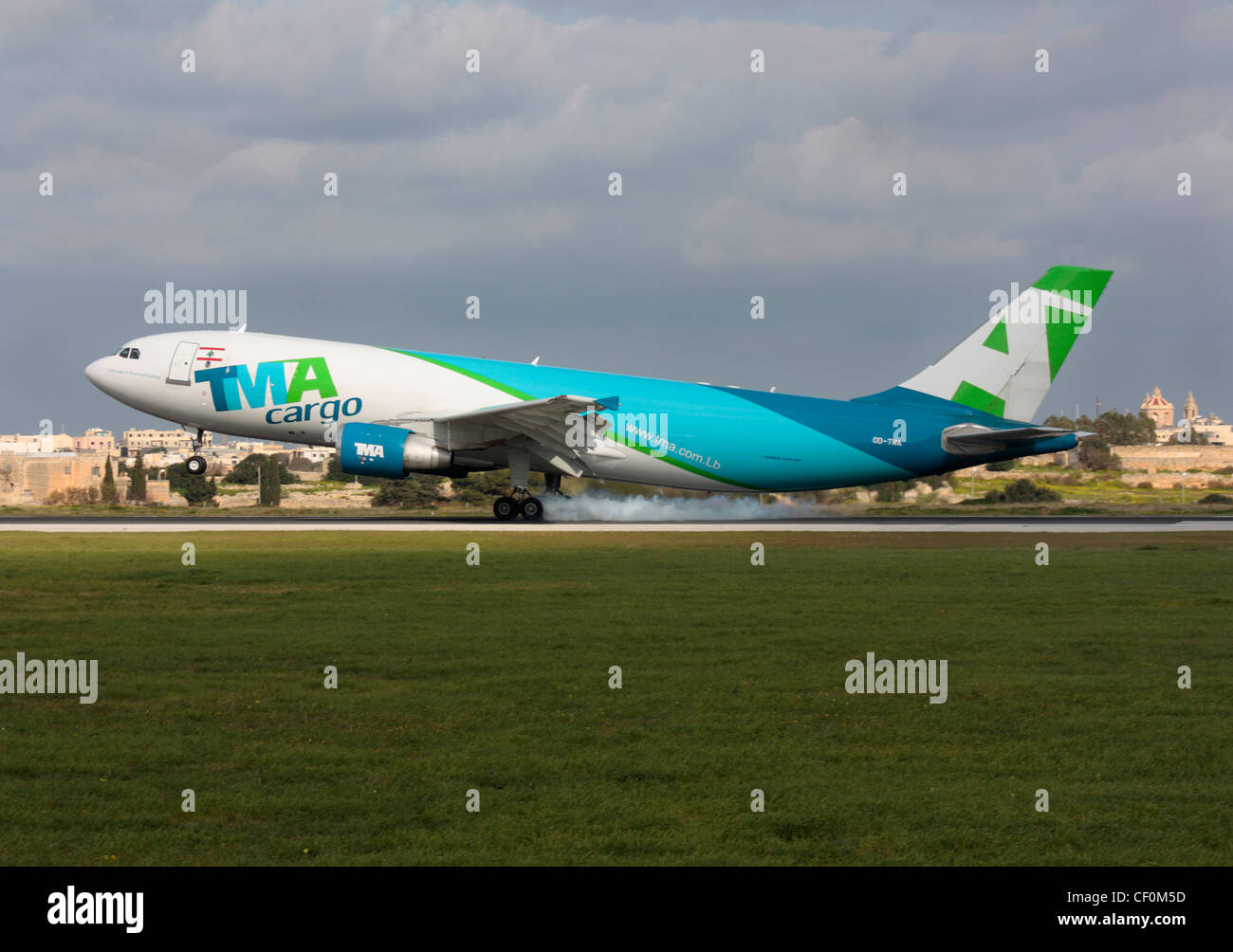 TMA Cargo Airbus A300-600F touching down at Malta International Airport - Stock Image