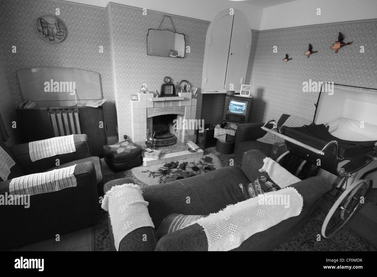 Example of a 1950's sitting room, complete with 405 line television. - Stock Image