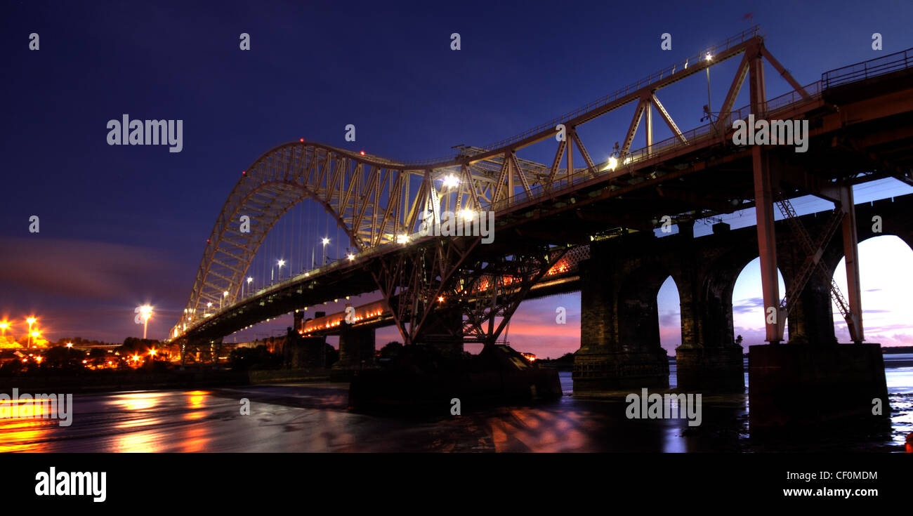 Runcorn Passenger Road Bridge at Night. Dusk image from the Widnes side, south of the Mersey river on its way to Stock Photo