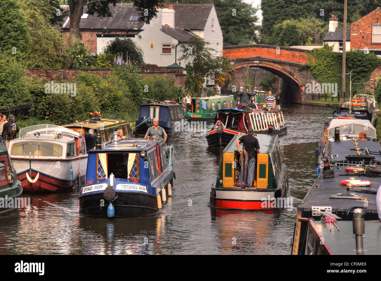 English Canal Boats Rush hour on The Bridgewater Canal, Lymm, Cheshire, England, UK - Stock Image