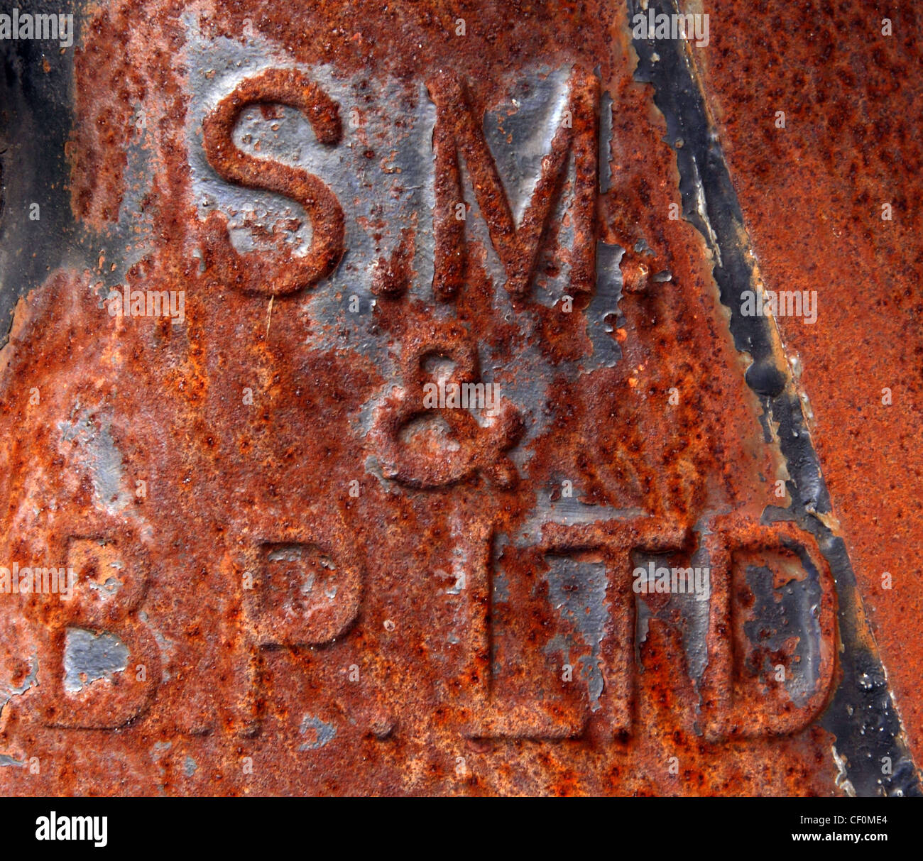 Red Rusty Vintage SM & BP (Shell Mex and British Petroleum) farm container - Stock Image