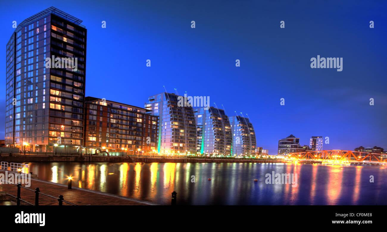 Dusk view of Housing developments blocks of flats at Salford Quays, Manchester, North West England - Stock Image