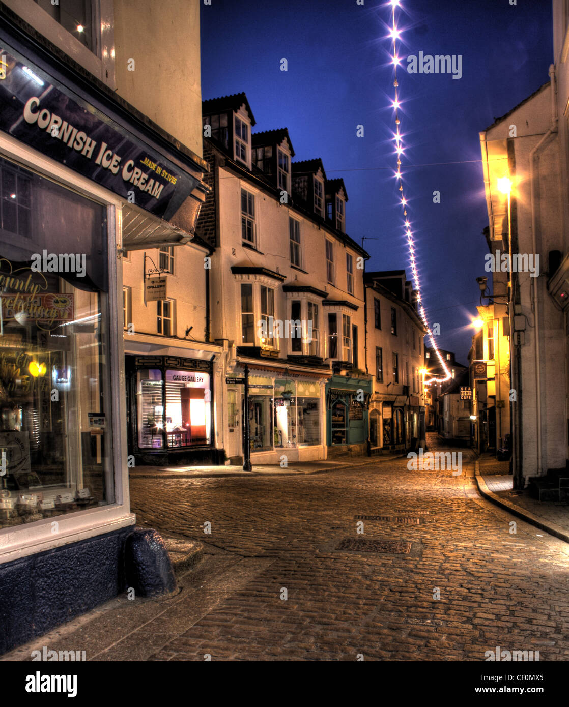 Dusk in St Ives Town, Fore Street, Cornish Ice Cream Shop, Cornwall, South West England, UK - Stock Image