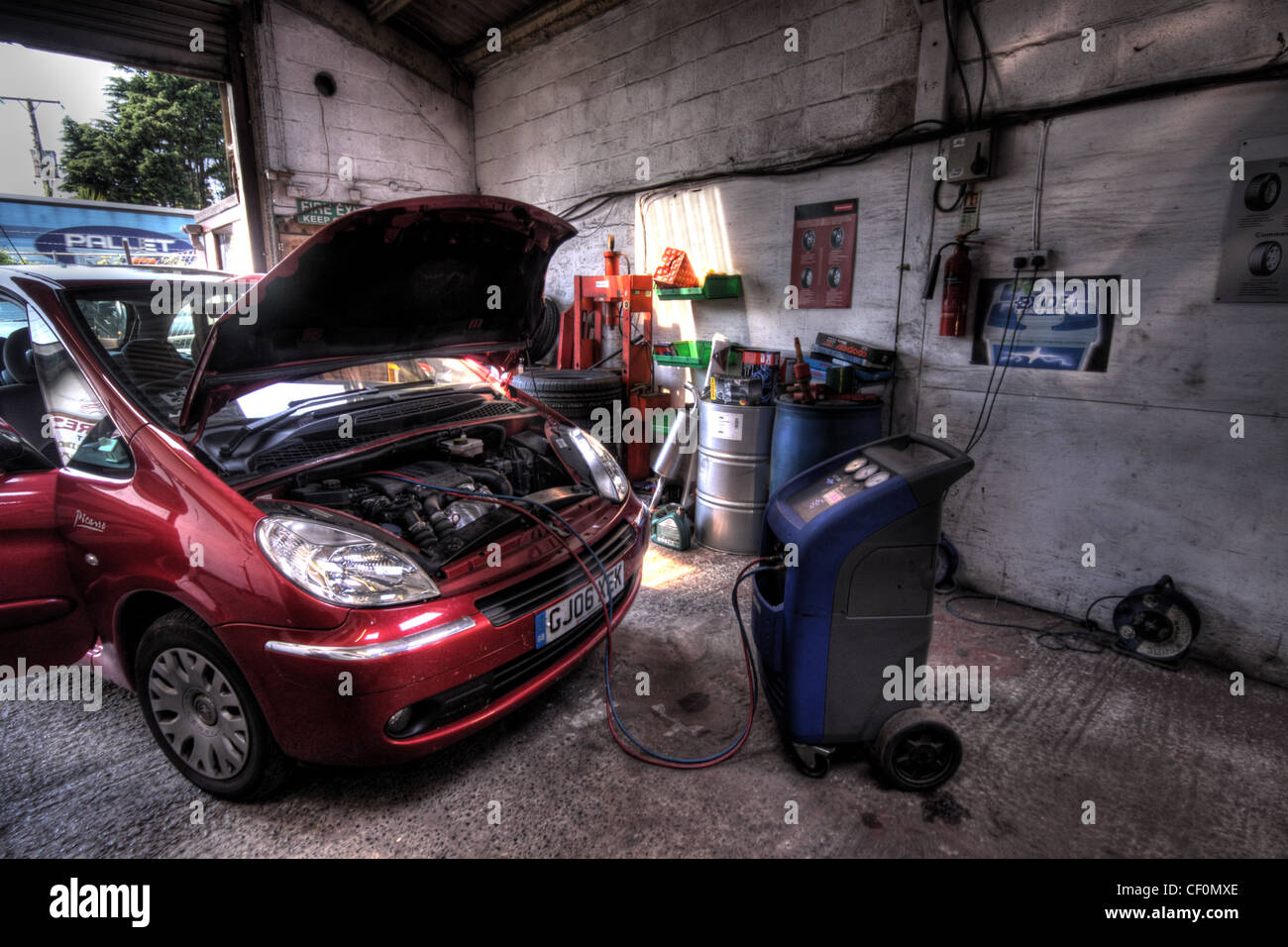 Picasso car in garage having air conditioning recharged - Stock Image