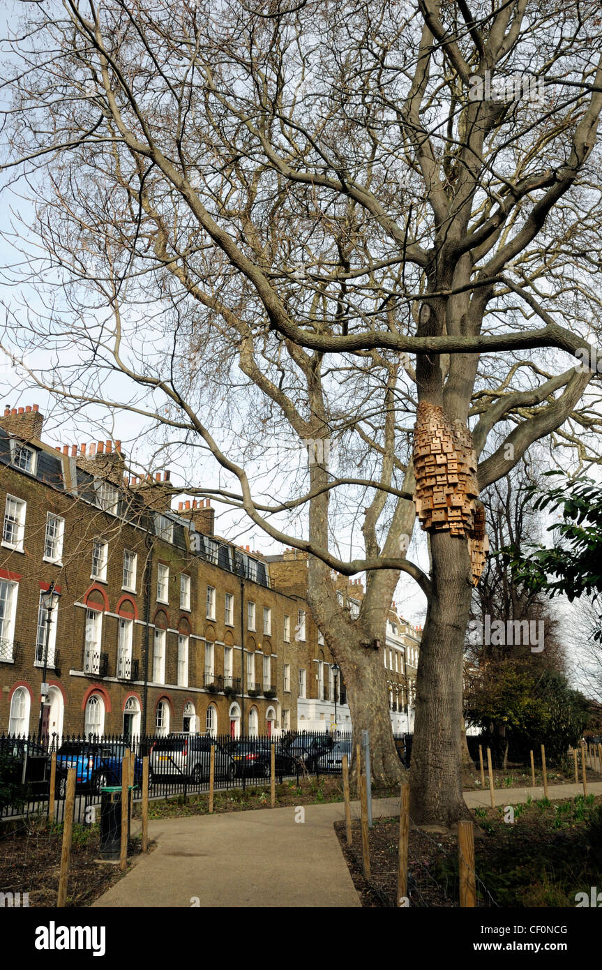 Over 250 bird and bug boxes, a sculptural installation, Spontaneous City Tree of Haven, in Duncan Terrace Gardens, - Stock Image