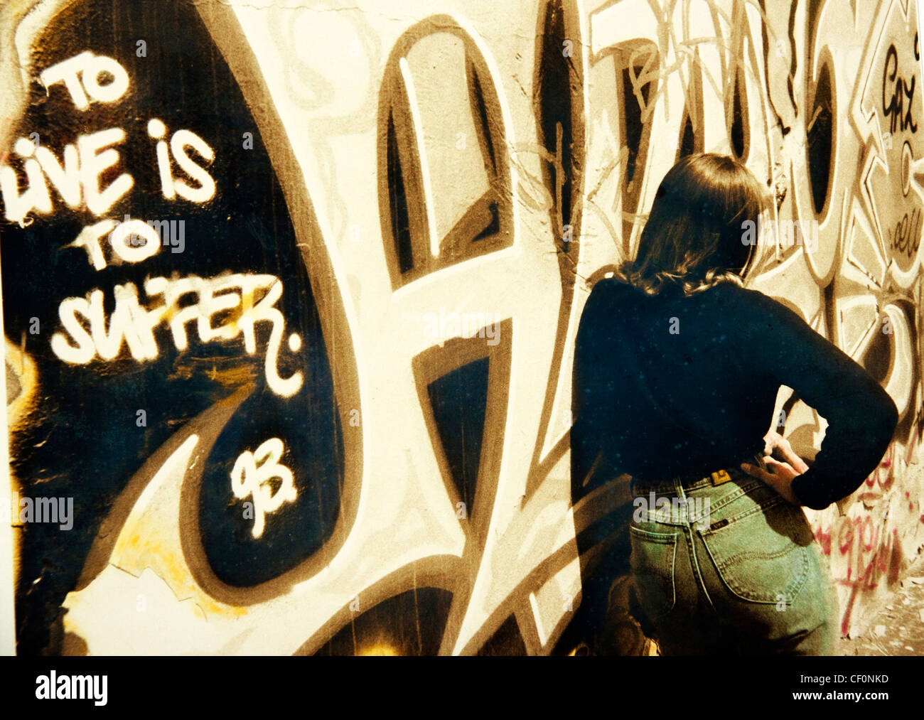 Graffiti at Trafford Park, Manchester, Lancashire, England, UK with a teenager - Stock Image