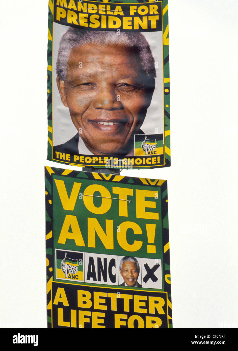 Posters urge voters in South Africa's first multi-racial elections in 1994 to elect black activist Nelson Mandela, - Stock Image
