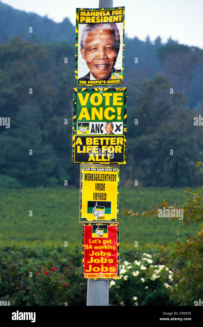Posters urge voters in South Africa's first multi-racial presidential election in 1994 to elect black activist - Stock Image