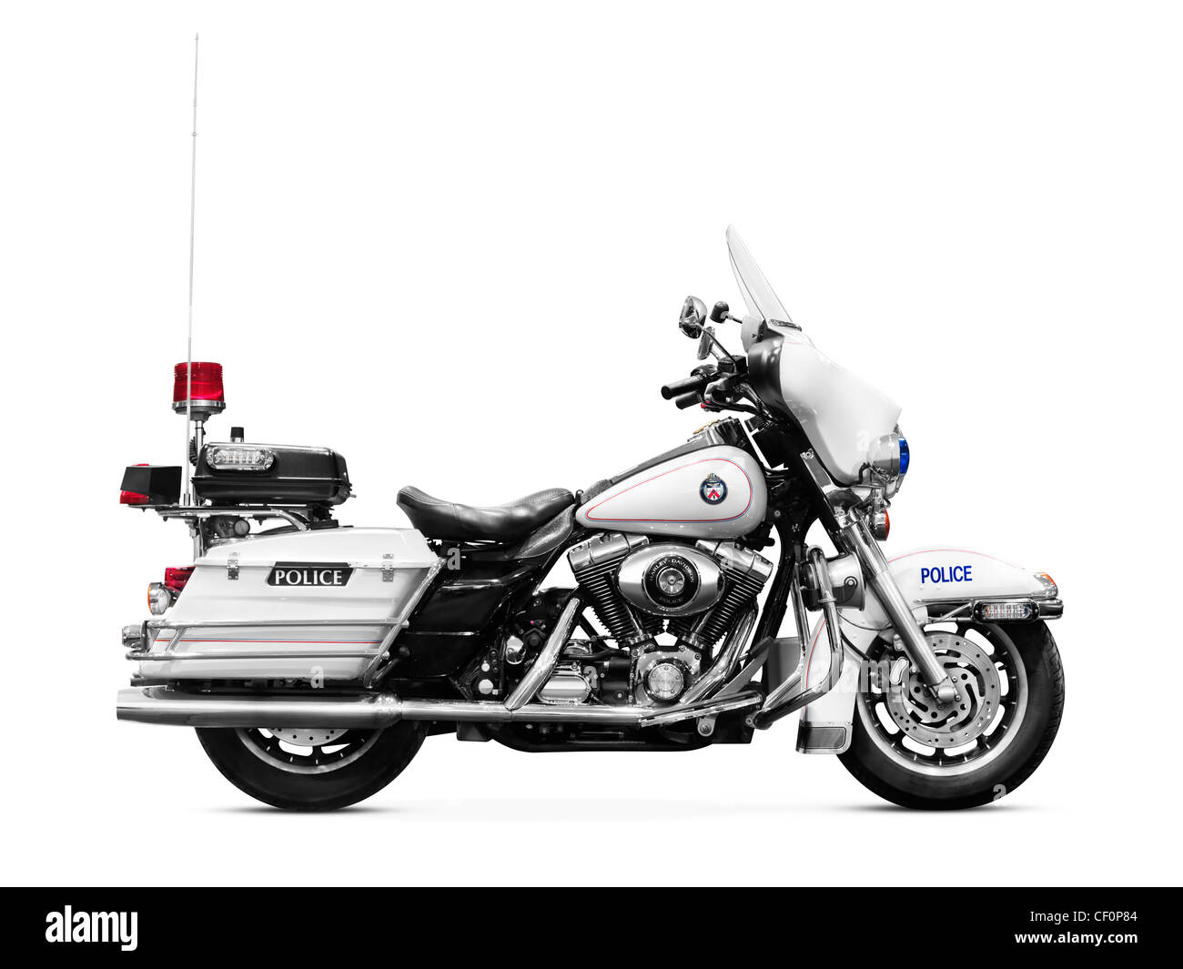 Police motorbike Harley Davidson FLHTP side view isolated on white background - Stock Image