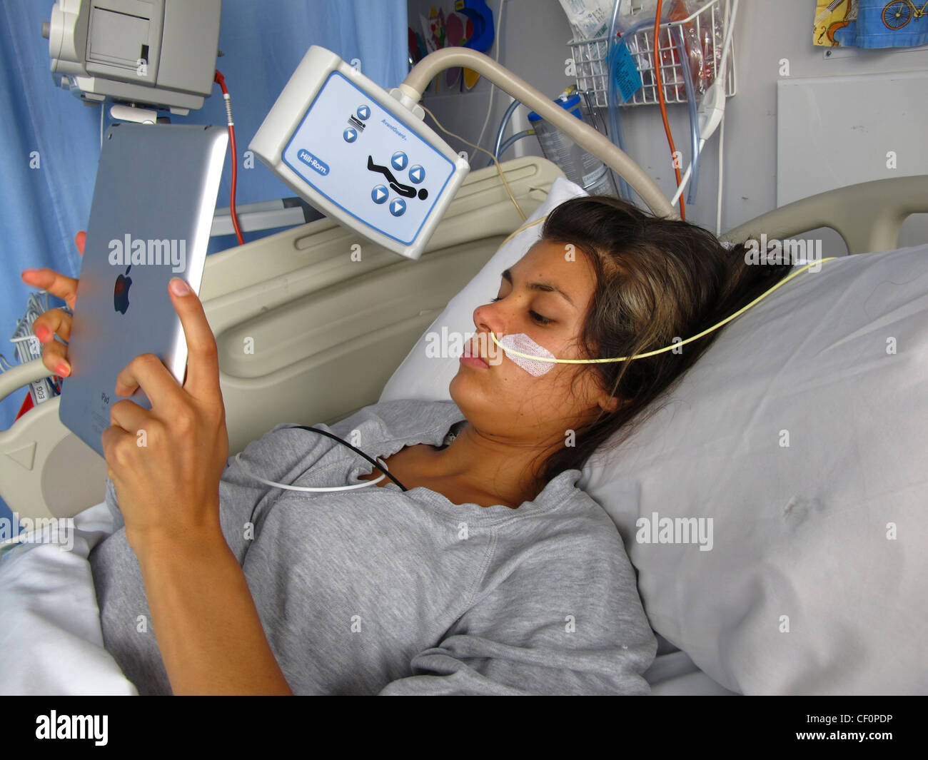 A Young Girl In Hospital With Anorexia Using An IPad