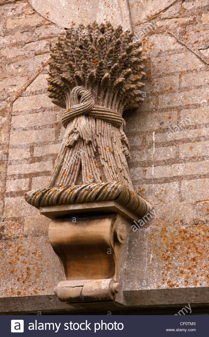Decorative carved / sculpted stone masonry wheatsheaf, Easton Walled Gardens, Easton, Grantham, Lincolnshire, England, - Stock Image