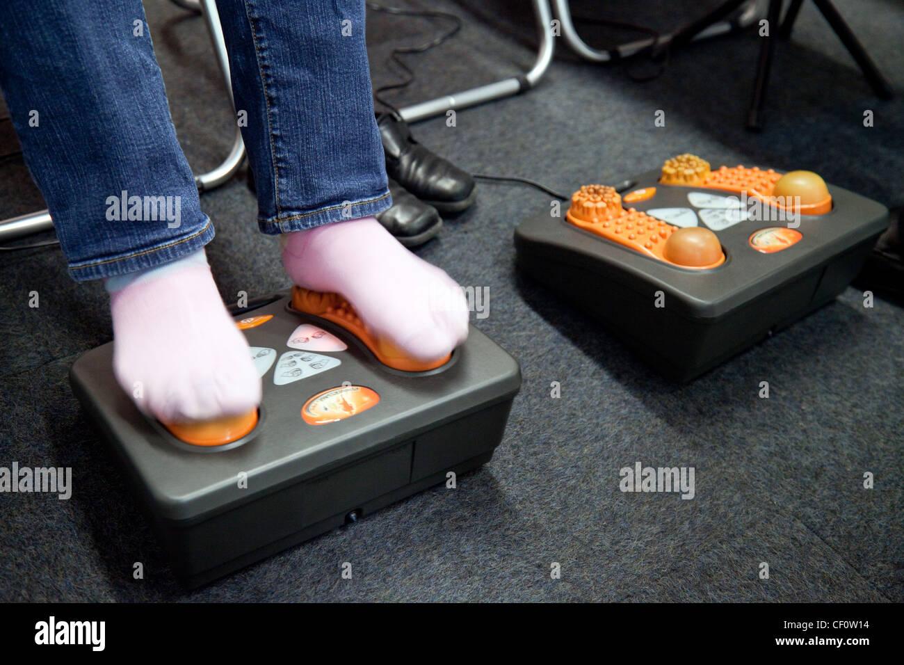Foot pain therapy treatment massage,  London 2012 UK - Stock Image