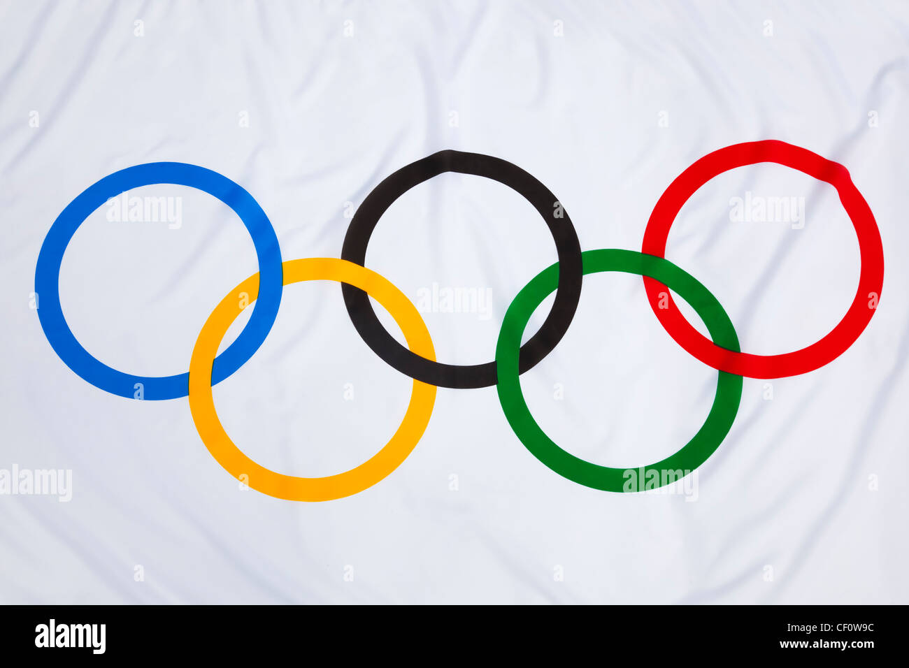 Olympic games rings on flag - Stock Image