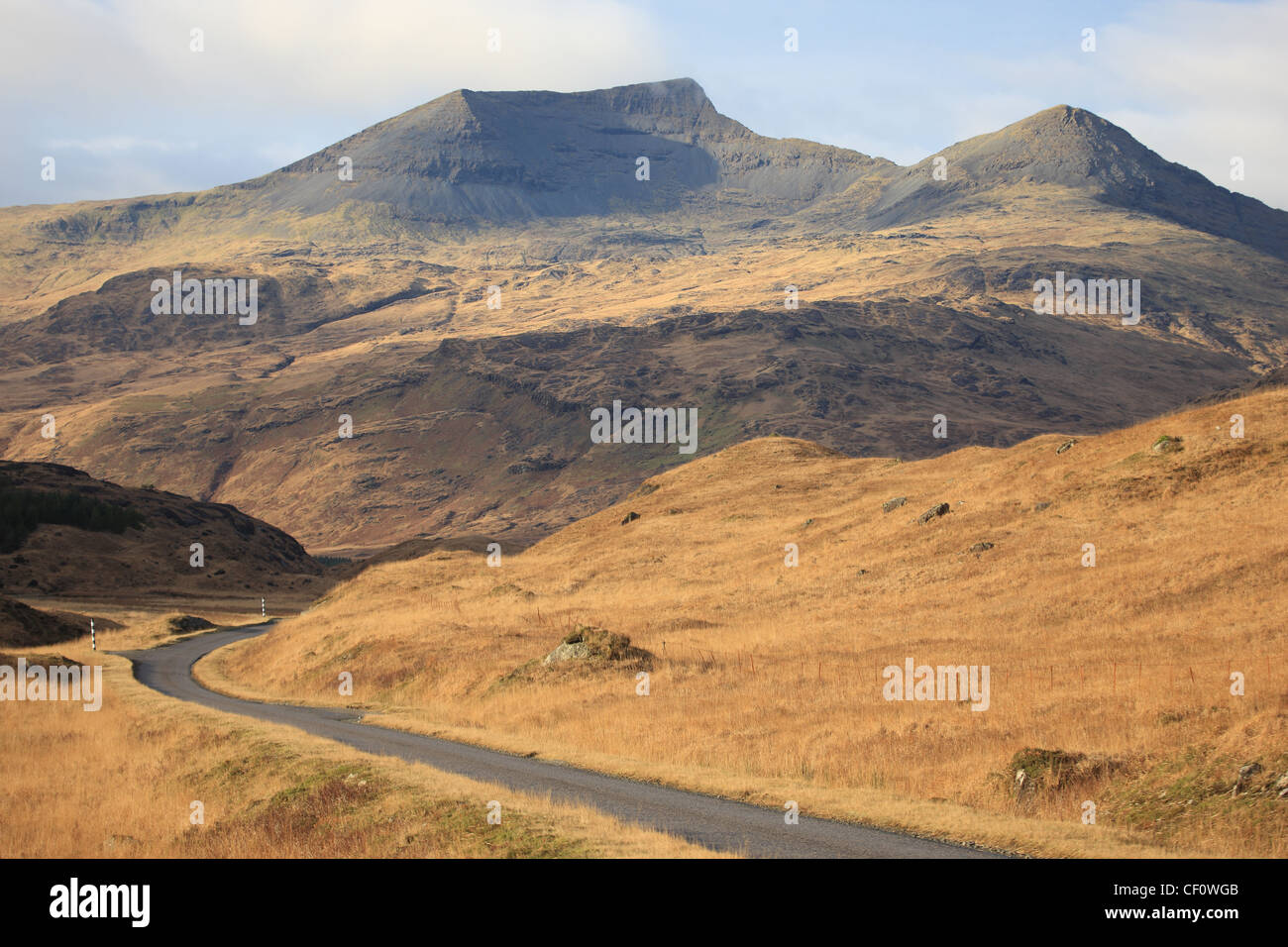 The A849 winding its way through Glen More on the Isle of Mull with Ben More (left) and A'Chioch (right) - Stock Image