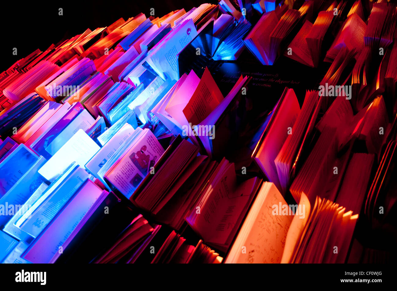 Book shelf artistic display with different colours - Stock Image