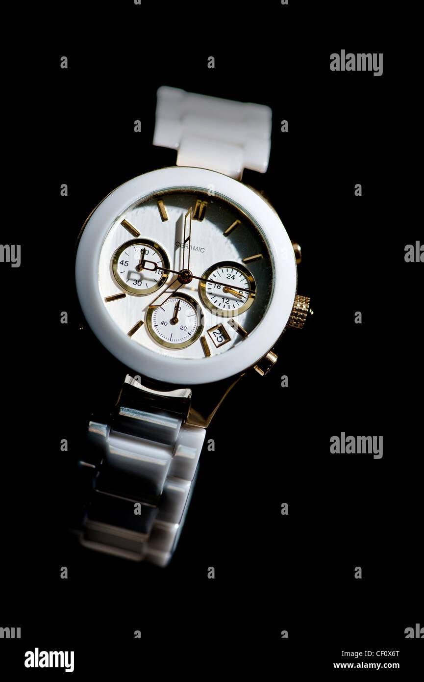 White fashionable watch photographed on black - Stock Image