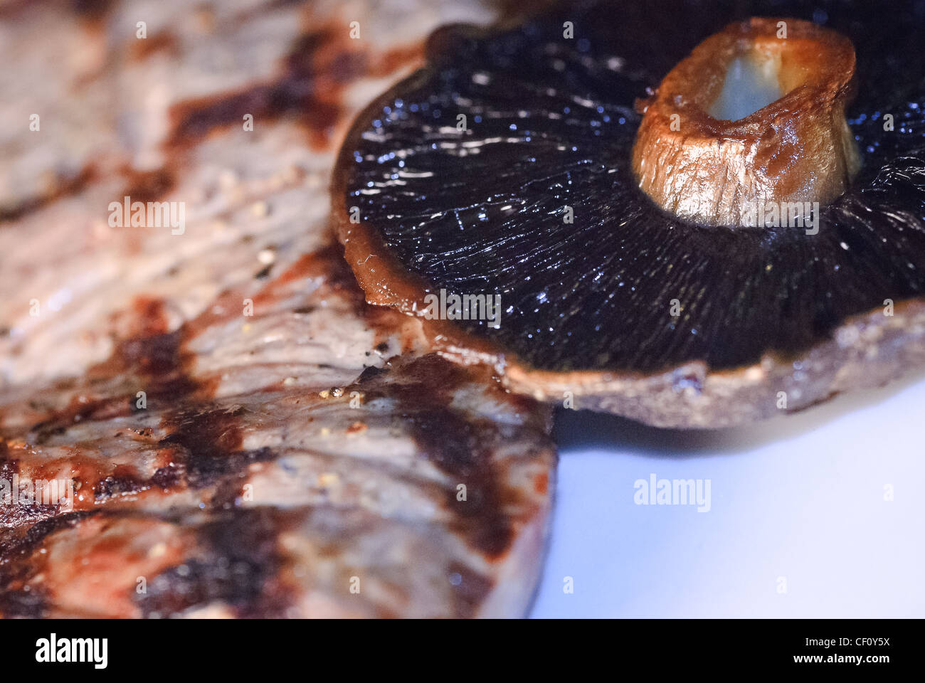 A meal containing mushrooms and steak - Stock Image