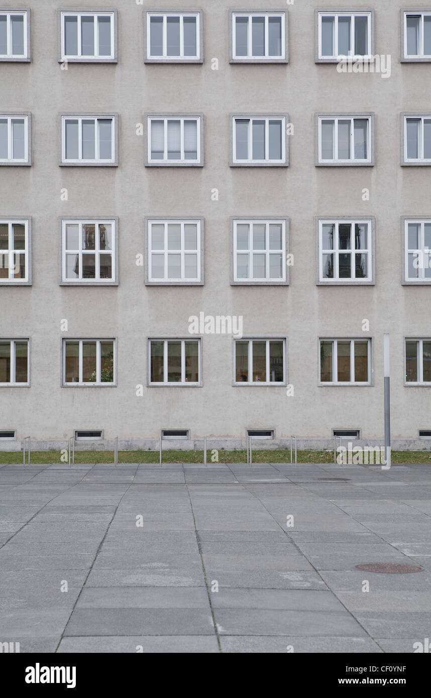 Grey housing, apartment buildings with symmetrical and ordered architecture. - Stock Image