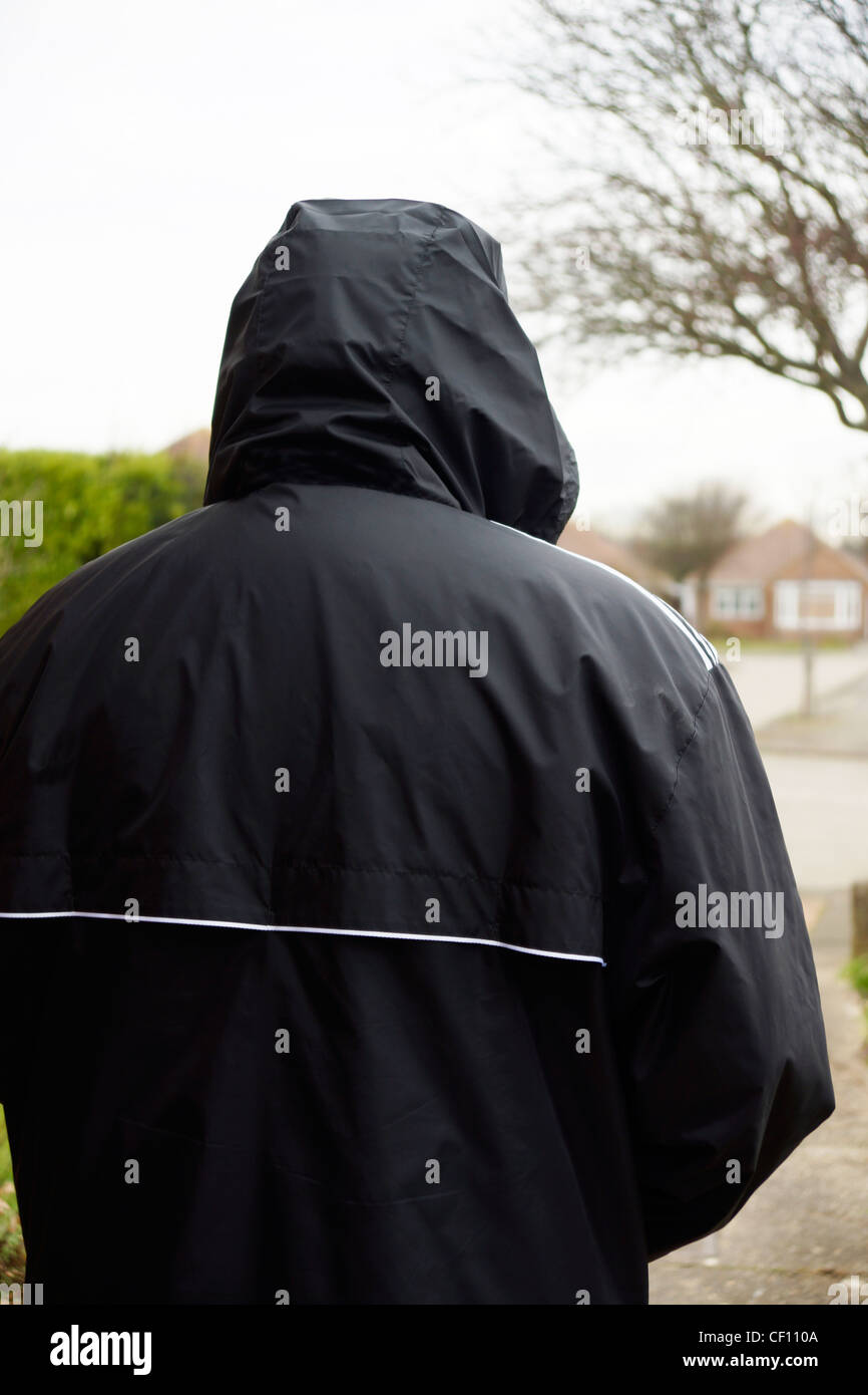 Undesirable character rogue hoodie acting suspiciously MODEL RELEASED - Stock Image