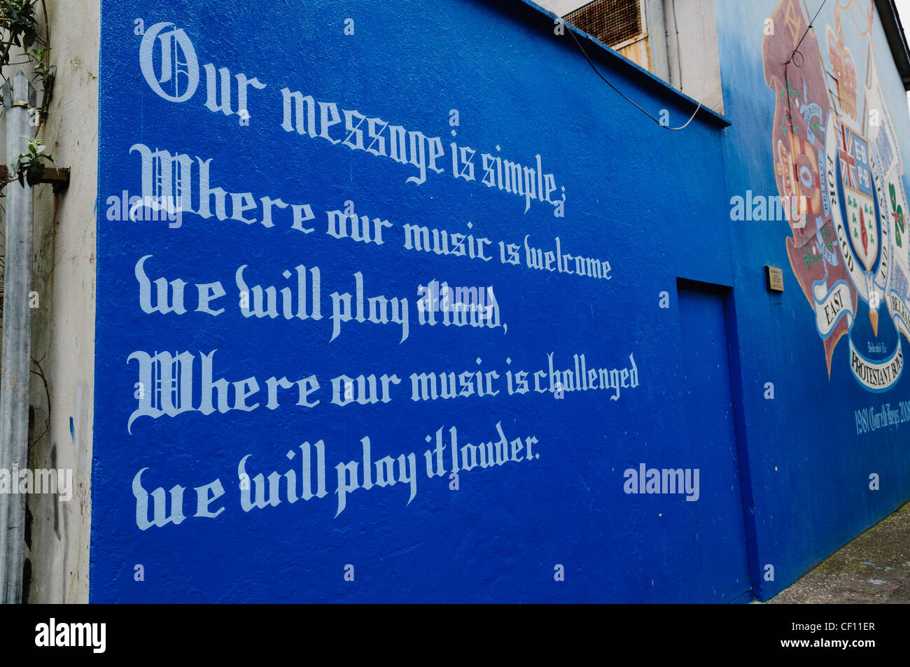 Message on East Belfast Mural 'Where our music is welcome we will play it loud. Where it is challenged we will - Stock Image