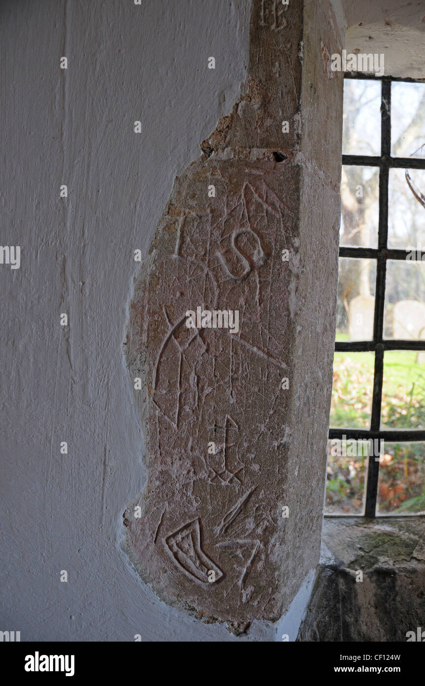 Ancient graffiti scratched on the wall of the entrance porch of st marys church apuldram
