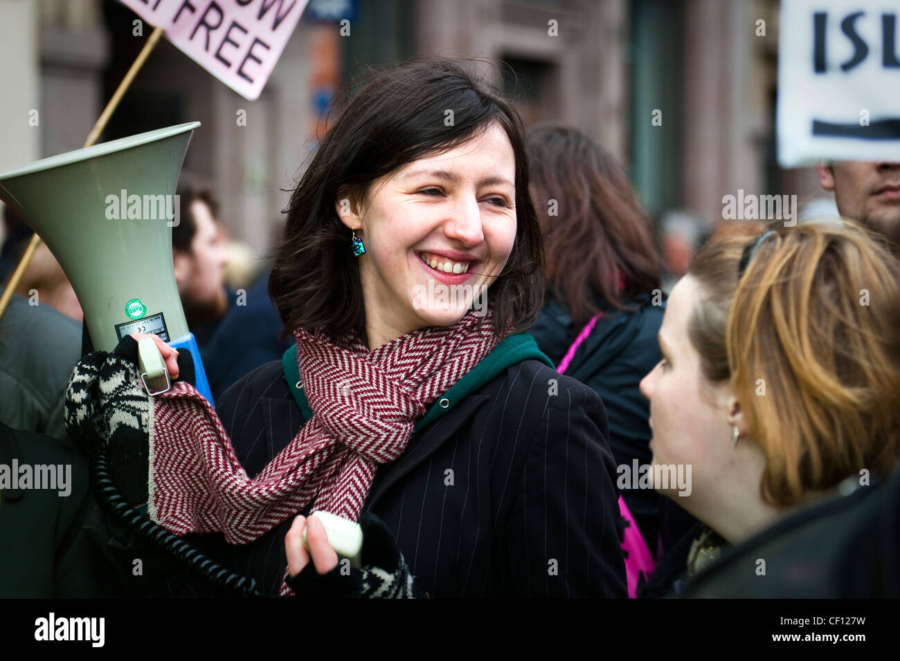 Young woman a with a loudspeaker at a street demonstration against racism, Glasgow, Scotland - Stock Image