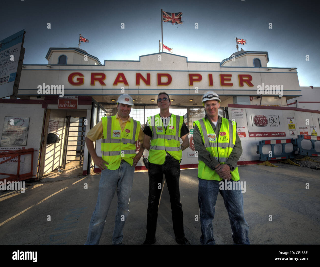 Construction workers putting final touches to the Grand Pier, ruined by fire, at Weston Super Mare , Avon , England - Stock Image