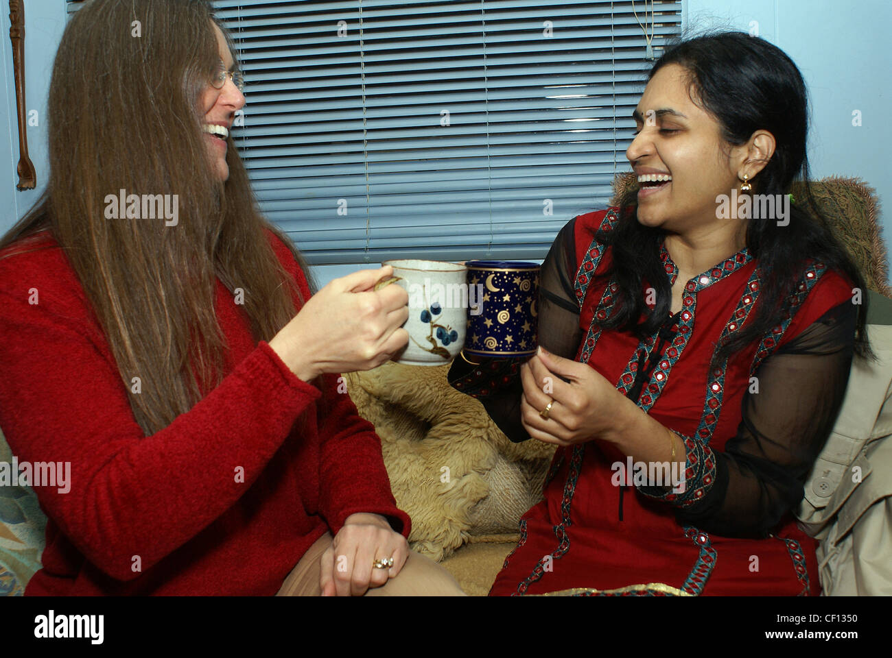 Friendly women from different cultures enjoying a coffee break. - Stock Image
