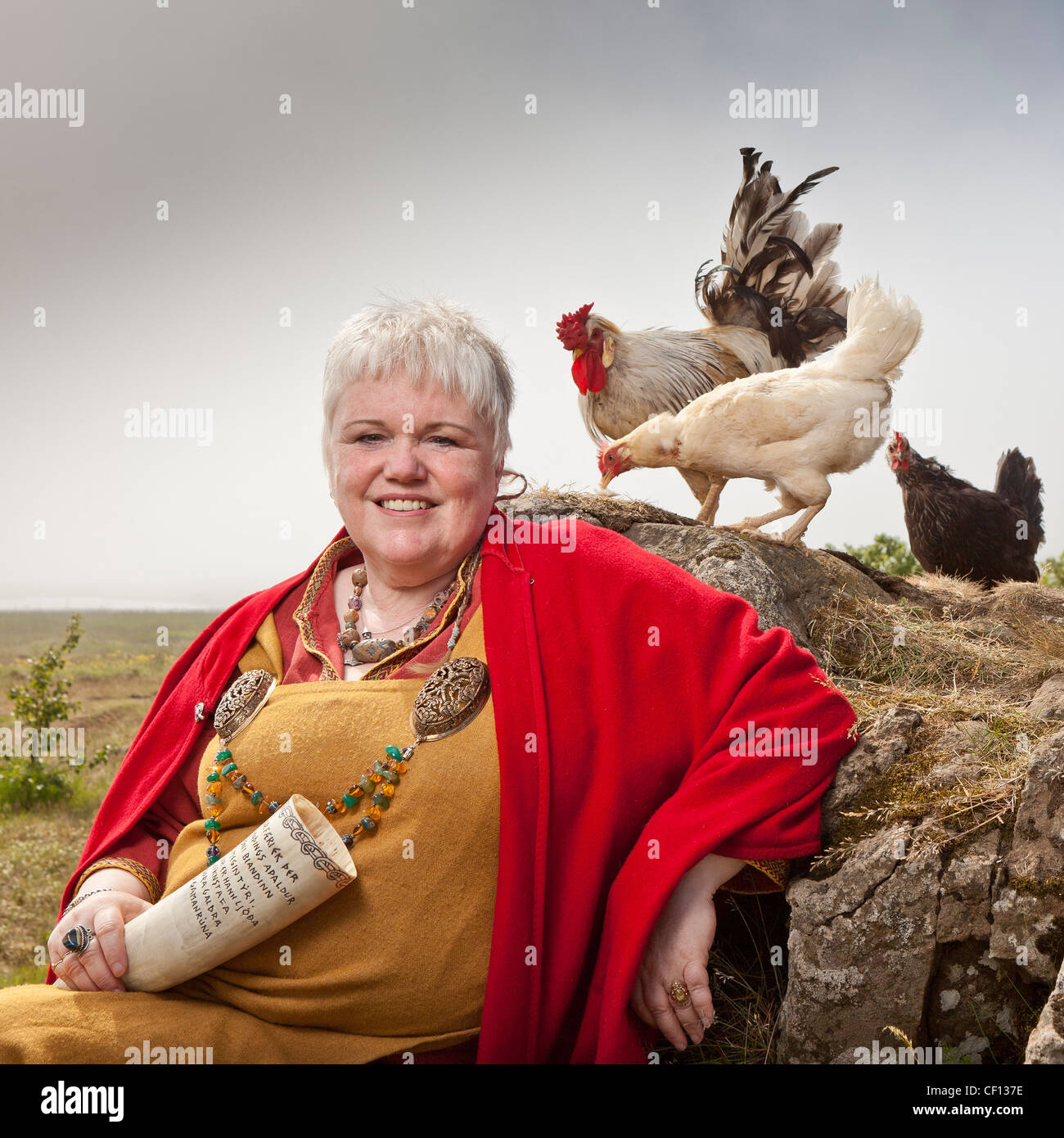 Icelandic Female priest on her farm with chickens, Hvalfjordur, Iceland - Stock Image