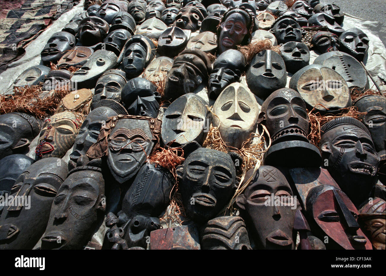 Carved wooden tribal masks on sale in an open air market in Johannesburg, South Africa in 1996 - Stock Image