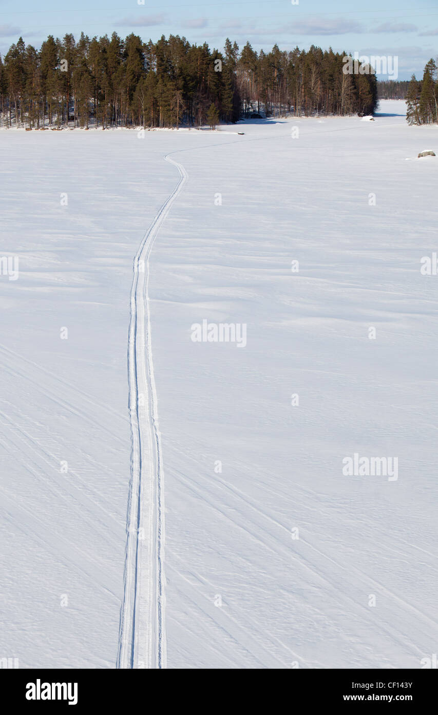 Snowmobile trail on lake ice , Finland - Stock Image