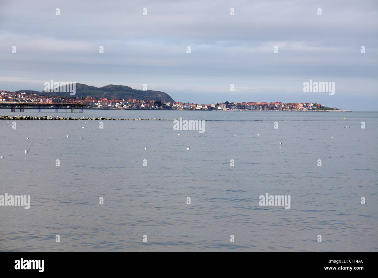 The north wales seaside resort of Colwyn Bay and Rhos on Sea with the Great Orme at Llandudno in the background. - Stock Image
