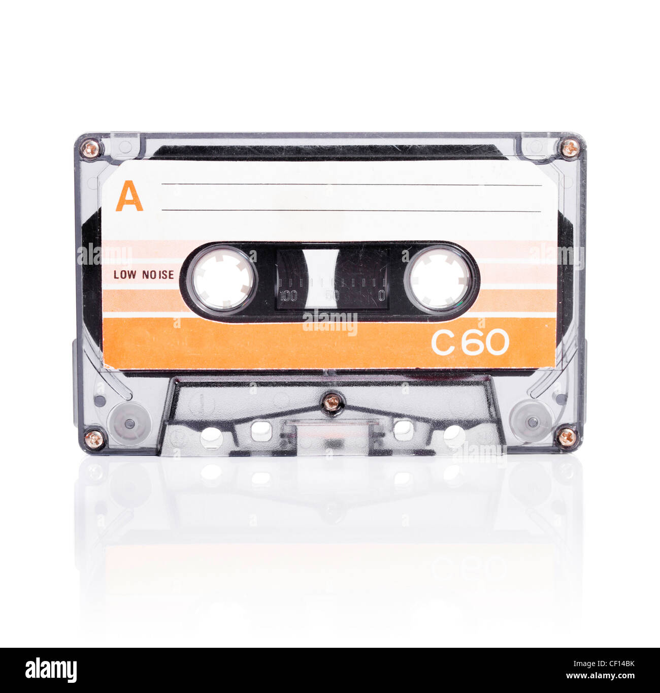 Old compact cassette audio tape isolated on white with natural shadow. - Stock Image