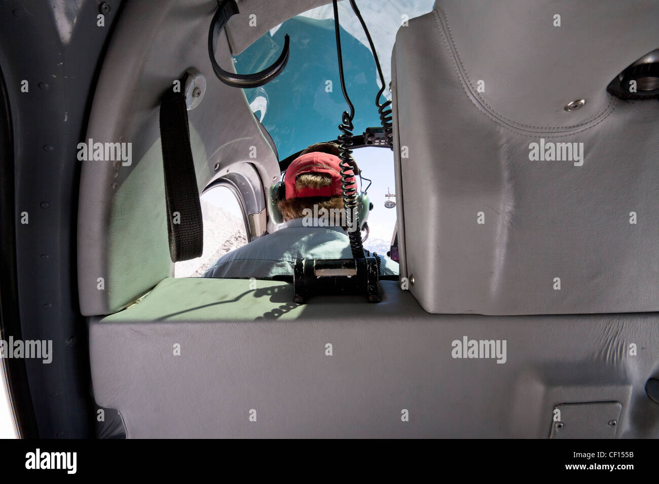 Detail of interior mountain helicopter and pilot landing on peak of Mount Cook the highest mountain in New Zealand. - Stock Image
