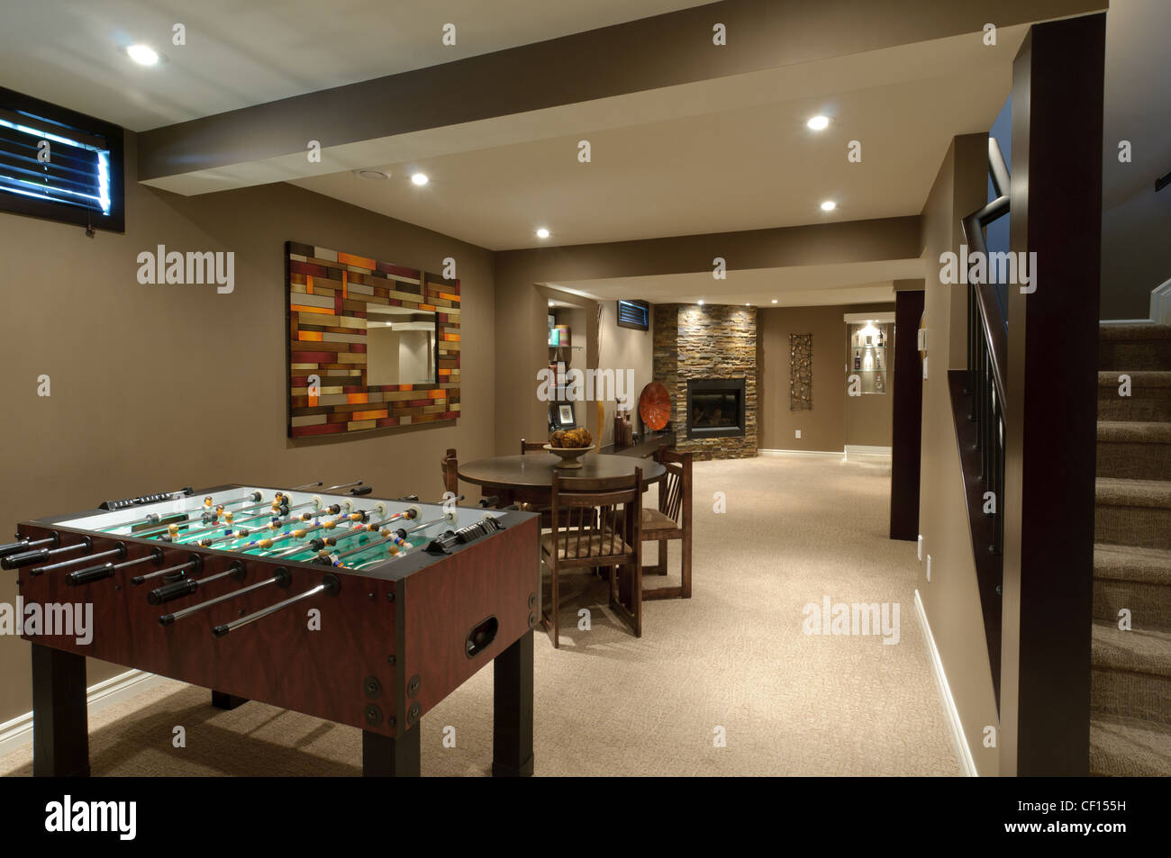 Superieur Basement In A Luxury Residential Home With Foosball And Card Tables.
