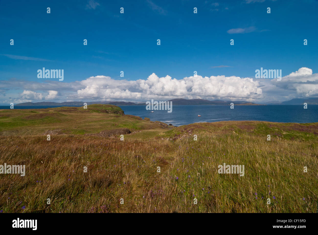 On the Island of Staffa looking out to sea with a band of cloud in the horizon over Ulva and Mull in the distance - Stock Image