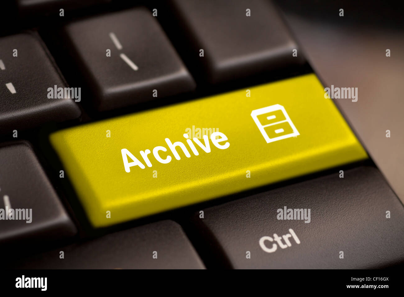 the yellow archive enter button key - Stock Image