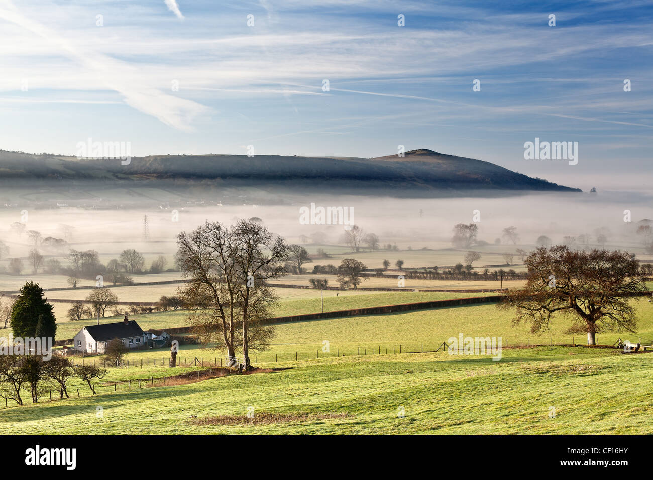 Crook Peak and The Mendips from Wint Hill on a misty winter morning at sunrise - Stock Image