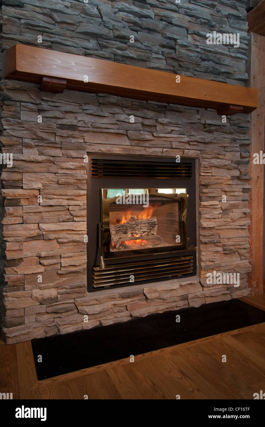 Wood burning fireplace in luxury residential home. - Stock Image