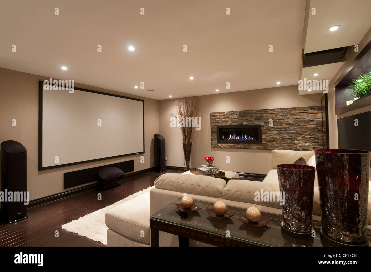 Basement In Luxury Residential Home With Sofa And Large Projection Screen  Home Theater.