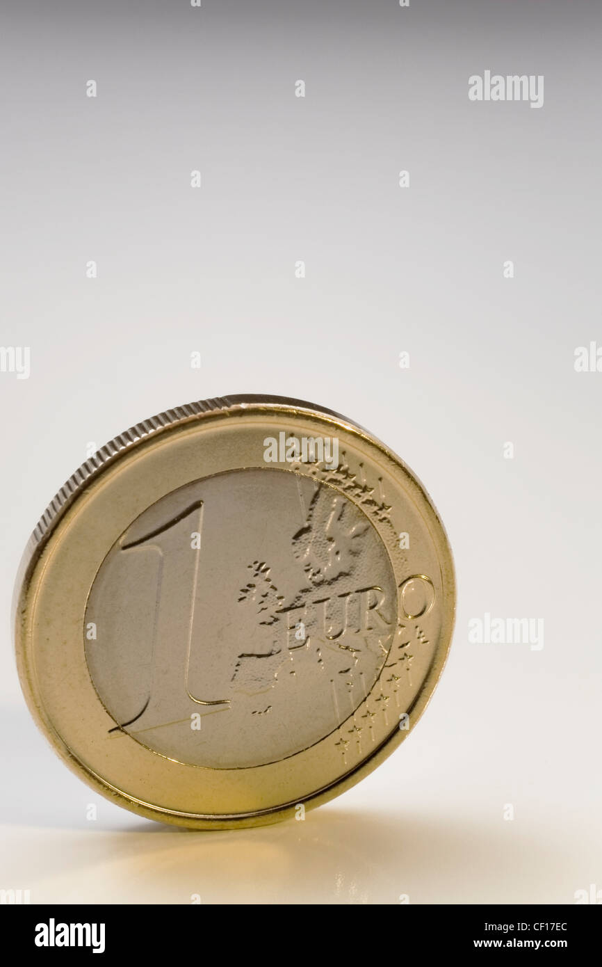 One Euro Coin Upright On A White Background - Stock Image