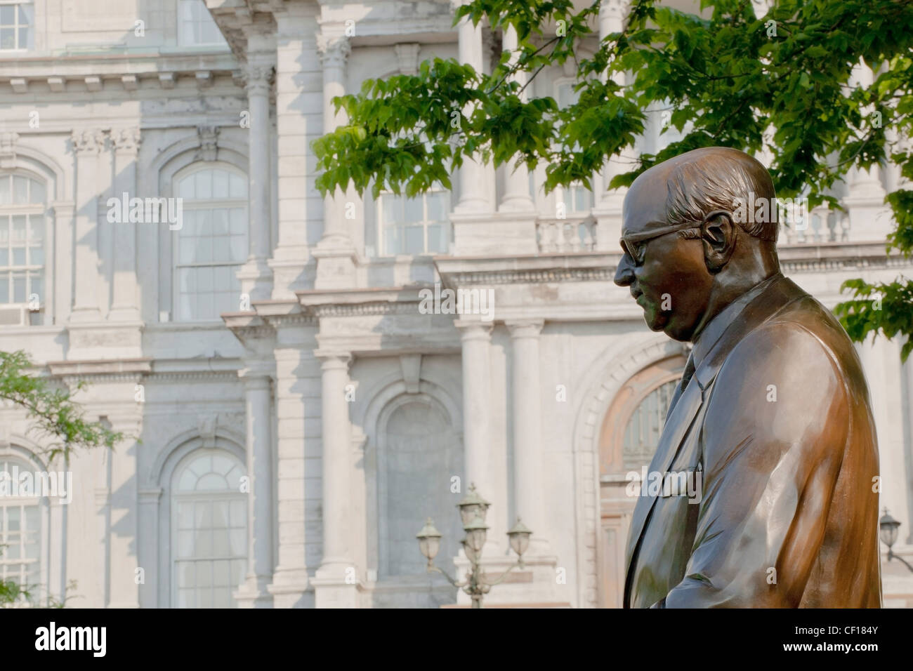 Statue Of Mayor Jean Drapeau With Montreal City Hall In The Background; Montreal Quebec Canada Stock Photo