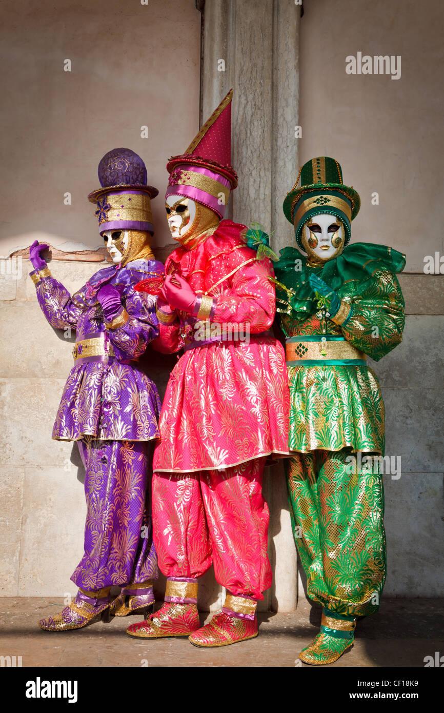 Three women dressed up for the Carnival in Venice, Veneto, Italy Stock Photo