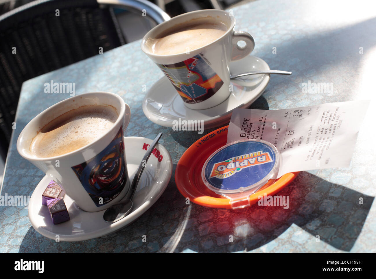 French Cafe - coffee cups and bill - Stock Image