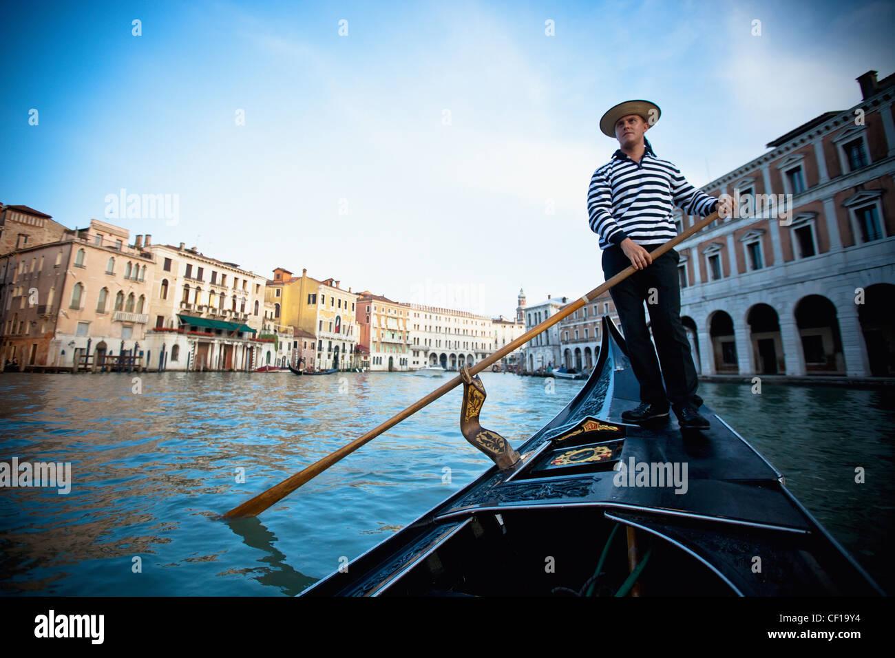 A Gondolier Rowing A Gondola; Venice Venezia Italy - Stock Image